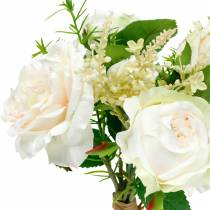 Bouquet of artificial roses. Cream silk flowers in a bouquet