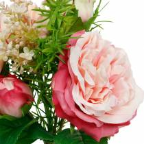 Bouquet of artificial roses in a bunch of pink silk flowers bouquet